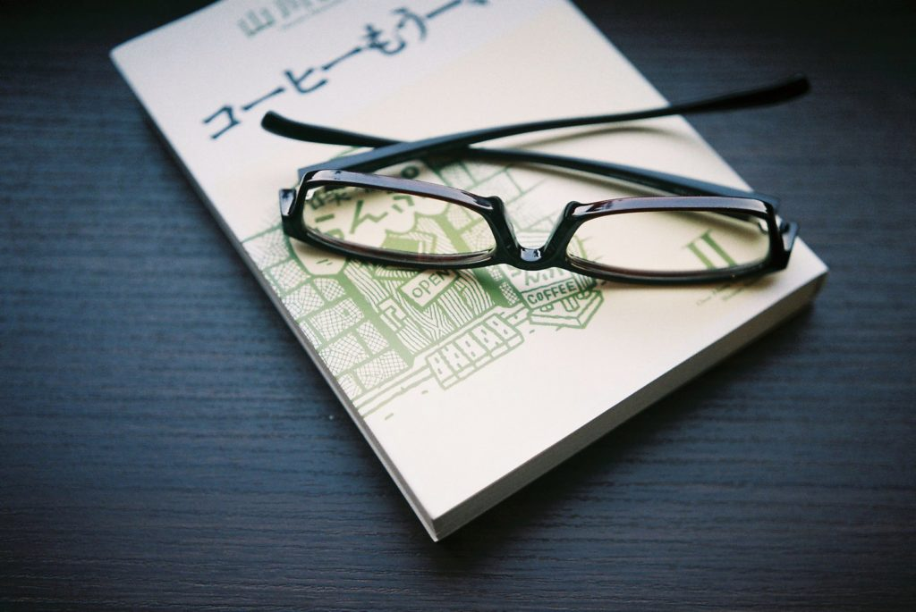 Photo of glasses resting on a book